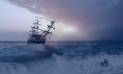 Türaufkleber Schiff Sailing ship in storm sea against heavy sunset clouds