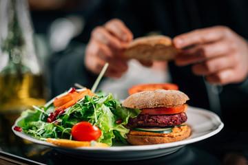 Chef Making Vegan Burgers in a Restaurant Kitchen