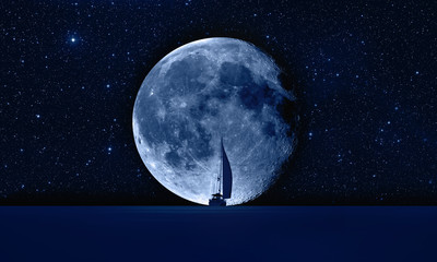 Wall Mural - Lone yacht with super Blue Moon
