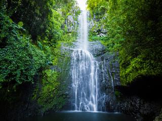 Maui, Hawaii Hana Highway - Wailua Falls, near Lihue, Kauai. Road to Hana connects Kahului to the town of Hana Over 59 bridges, 620 curves, tropical rainforest
