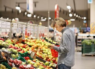 Man buying fruits at the market