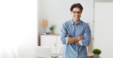 Confident Freelancer Guy Crossing Hands Standing In Home Office, Panorama