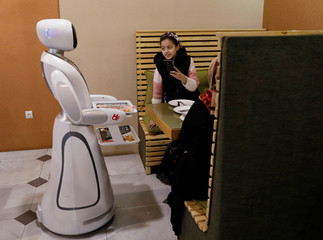 A waitress robot (Timea) delivers food to customers at the Times Fast Food restaurant in Kabul