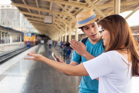 Asian woman speaking fluent foreign language with foreigner; concept of communication with foreign language, foreign tourist or caucasian traveler, language learning, language education training
