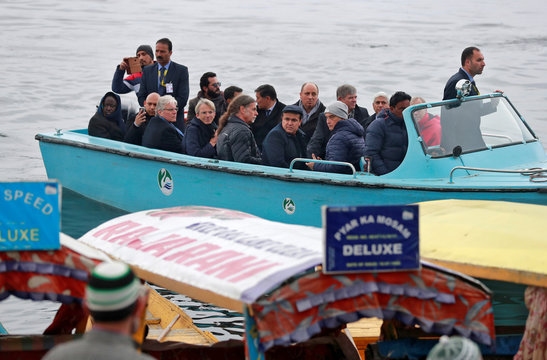 Foreign diplomats are seen in a motorboat in Dal Lake in Srinagar