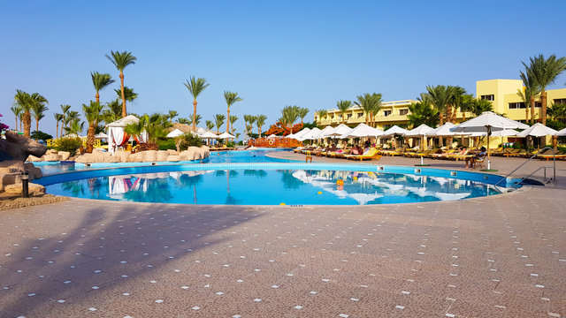 Sharm El Sheikh, Egypt - July 13, 2019: main pool and Amway territory. Luxurious hotel grounds. Landscaping and pool with sun loungers overlooking the sea. Hotel and spa in Sharm El Sheikh in Egypt