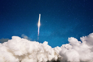 Spaceship takes off into space. Rocket launch into the sky with stars. Project start concept