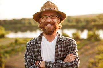 Cheerful bearded man in rural landscape