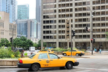 CHICAGO, USA - JUNE 26, 2013: Taxi cab drives in Chicago. Chicago is the 3rd most populous US city with 2.7 million residents (8.7 million in its urban area).