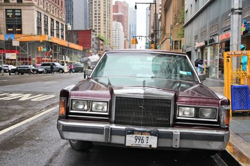NEW YORK, UNITED STATES - JUNE 10, 2013: Old Lincoln car parked at rainy 8th Avenue in New York. Lincoln Motor Company is part of Ford corporation and exists since 1917.