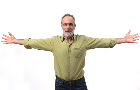 vital man with arms outstretched on white