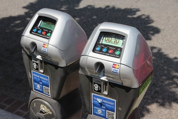 WASHINGTON DC, USA - JUNE 14, 2013: Parking meters in Washington DC. 646,000 people live in Washington DC (2013) making it the 23rd most populous US city.
