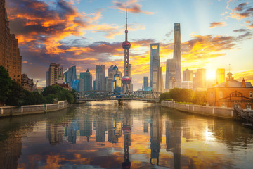 Wall Mural - morning time in shanghai city with bridge and building background