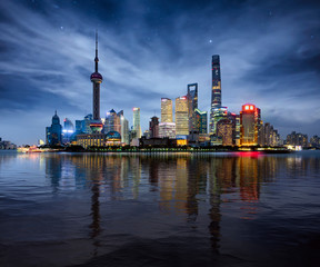Wall Mural - Night Cityscape of Shanghai, China city skyline on the Huangpu River.