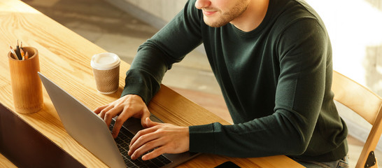 Fototapeta Unrecognizable Freelancer Guy Writing Article Working At Workplace Indoor, Panorama obraz
