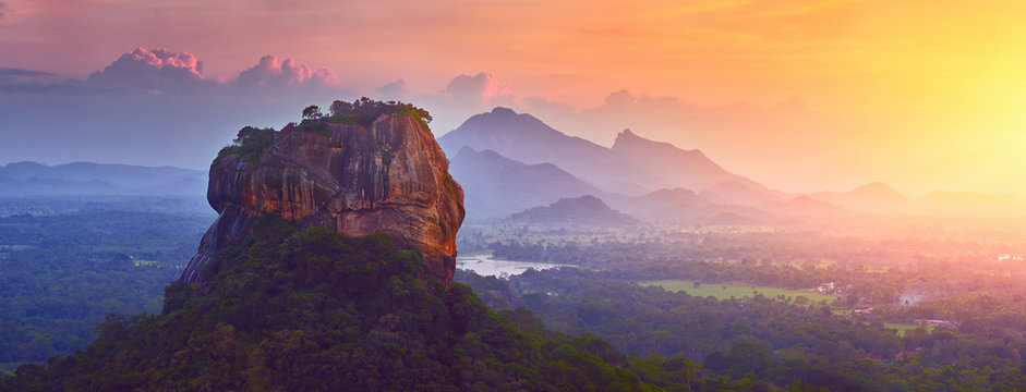 Panoramic view of the famous ancient stone fortress Sigiriya (Lion Rock) on the island of Sri Lanka, which is a UNESCO World Heritage Site.