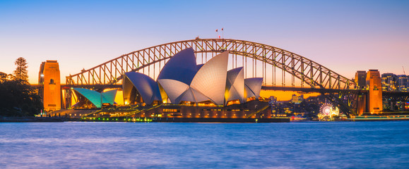 Fototapeten Sydney AUSTRALIA - AUGUST 12, 2019: Cityscape panorama view of Opera house with blue sky. The most famous tourist attraction in Sydney city, Australia.
