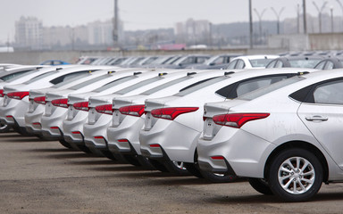 Minsk, Belarus. Jan 2020. Hyundai cars parked in the parking lot of an authorized dealer. New cars on the holding yard. Hyundai i40 vehicles on the parking in the row. Sale of new cars