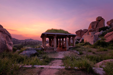 Ancient ruins of Hampi on sunset. India Fototapete