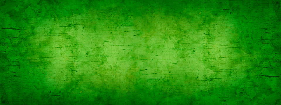 Abstract green grunge background. Toned old stained wood background. Green vintage banner. Copy space.
