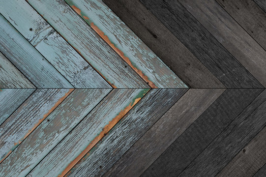 Black and blue wooden wall with herringbone pattern made of barn boards. Old weathered wood texture for background.