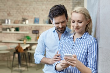 Young couple using mobile together
