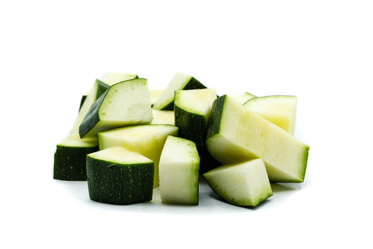slices of zucchini isolated on white background