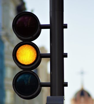 Red or yellow or green traffic lights with blurred background.