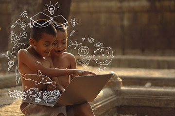 An Asian boy who enjoys learning online. E-Learning concepts