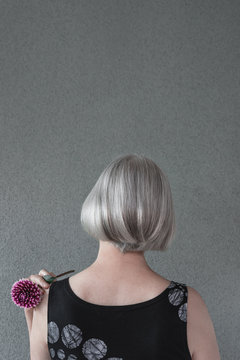 Lady with silver hair and red dahlia