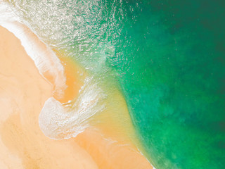 Aerial Drone Shot of ocean and sandy beach Green Torquoise