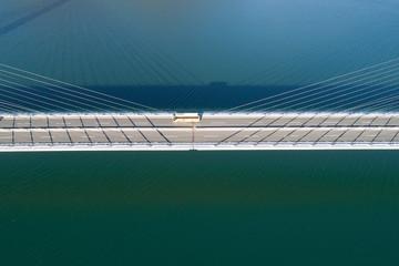 """Bus crossing bridge in """"Barrios De Luna"""" reservoir"""