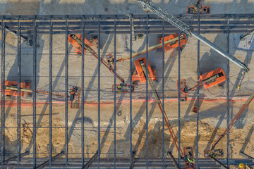 Workers constructing steel commercial building in Georgia