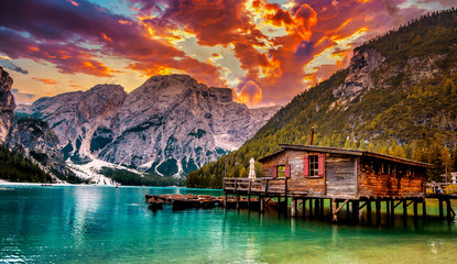 Fotobehang Aubergine Famous lake in the italian alps Dolomites, Lago di Braies. Place with typical wooden boats on the alpine lake