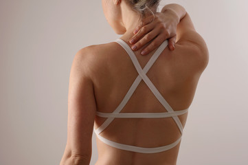Woman suffering from upper Back and Neck pain.