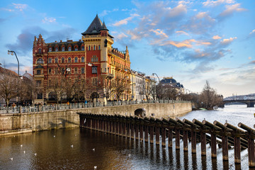 Fototapete - Prague Czech Republic. View at river Vltava and national theater, street with antique building. Evening scenic landscape with sunset sky.