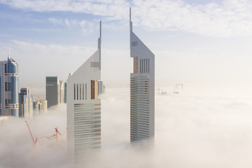 Aerial view of buildings surrounded by clouds Dubai, United Arab Emirates Fotomurales