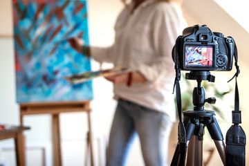 Female artist recording her video tutorial about art painting