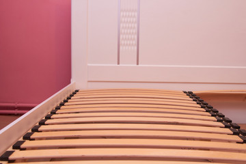 closeup of wooden slats in bed,double bed with orthopedic wooden slats for mattresses, assembly bed