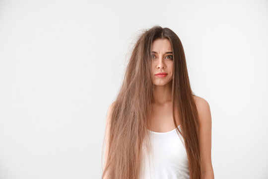Stressed woman with tangled and smooth hair on white background