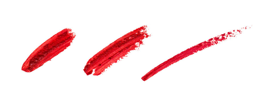 Smudged lipstick strokes for decoration design. Smear hand drawing lines. Red color cosmetic product brush stroke sample. Textured Paint line isolated on white background
