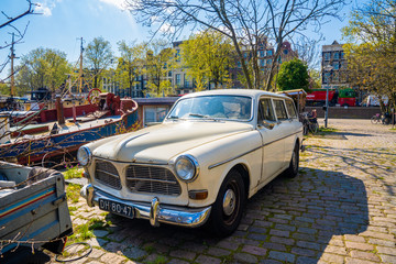 An old vintage 1967 Volvo Amazon 122S model parked in a quiet place in Amsterdam.