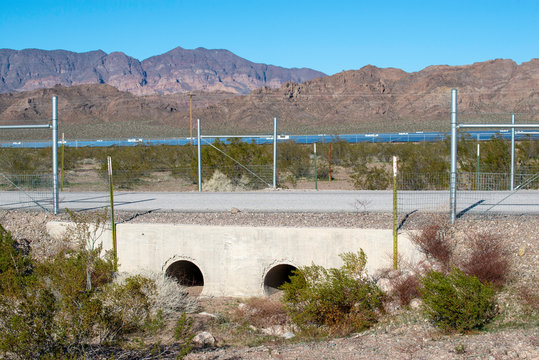 USA, Nevada, Clark County, Eldorado Valley, Boulder City. A specialized wildlife crossing with underpass designed to allow  threatened Mojave desert tortoise habitat access. Short fences keep them off
