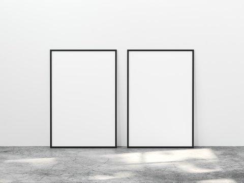 Two vertical black frame mock up on concrete floor with light overlays. Set of two black frame mock up poster. 2 vertical frame 3d illustrations.