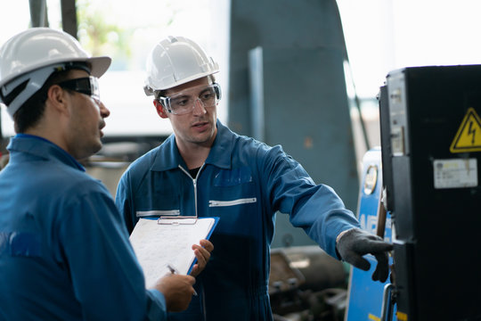 Professional team, quality control, stand maintenance, talk in the Warehouse factory. Team Engineer Factory operator Operating meetings