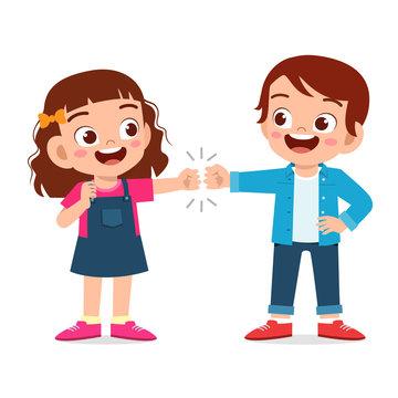 happy cute little kids boy and girl fist bump