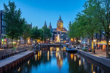 Amsterdam city skyline with Church of Saint Nicholas landmark in Amsterdam city, Netherlands