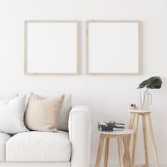 Two square wooden frame mock up with sofa and wooden side table on white wall in living room. 3D illustration.