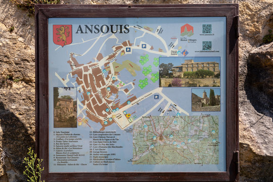 Ansouis France July 14th 2015 : Sign with a map of the town of Ansouis in Provence, indicating the locations of a variety of local sights