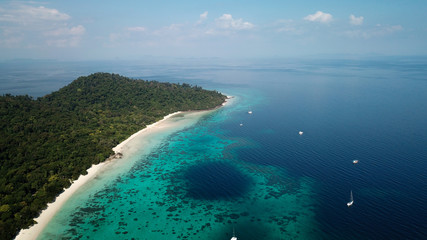 drone shot of koh rok in thailand, beautiful white beach with turquoise coral reef, big blue hole